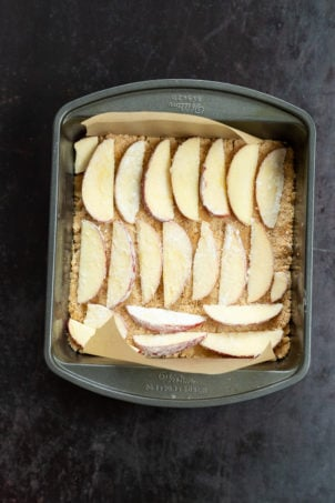 Apple over Crust for our Vegan Apple Custard Squares in a lined brownie pan