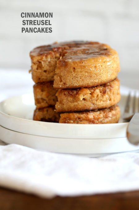 These Vegan Cinnamon Streusel Pancakes are a perfect treat for Valentines or a special day. A delicious fluffy vanilla pancake topped with a cinnamon streusel for a coffee cake like pancake. Make the pancakes in cookie cutters to make a cake like pancake tower! #Vegan #Pancakes #Soyfree #Nutfree #Recipe #VeganRicha