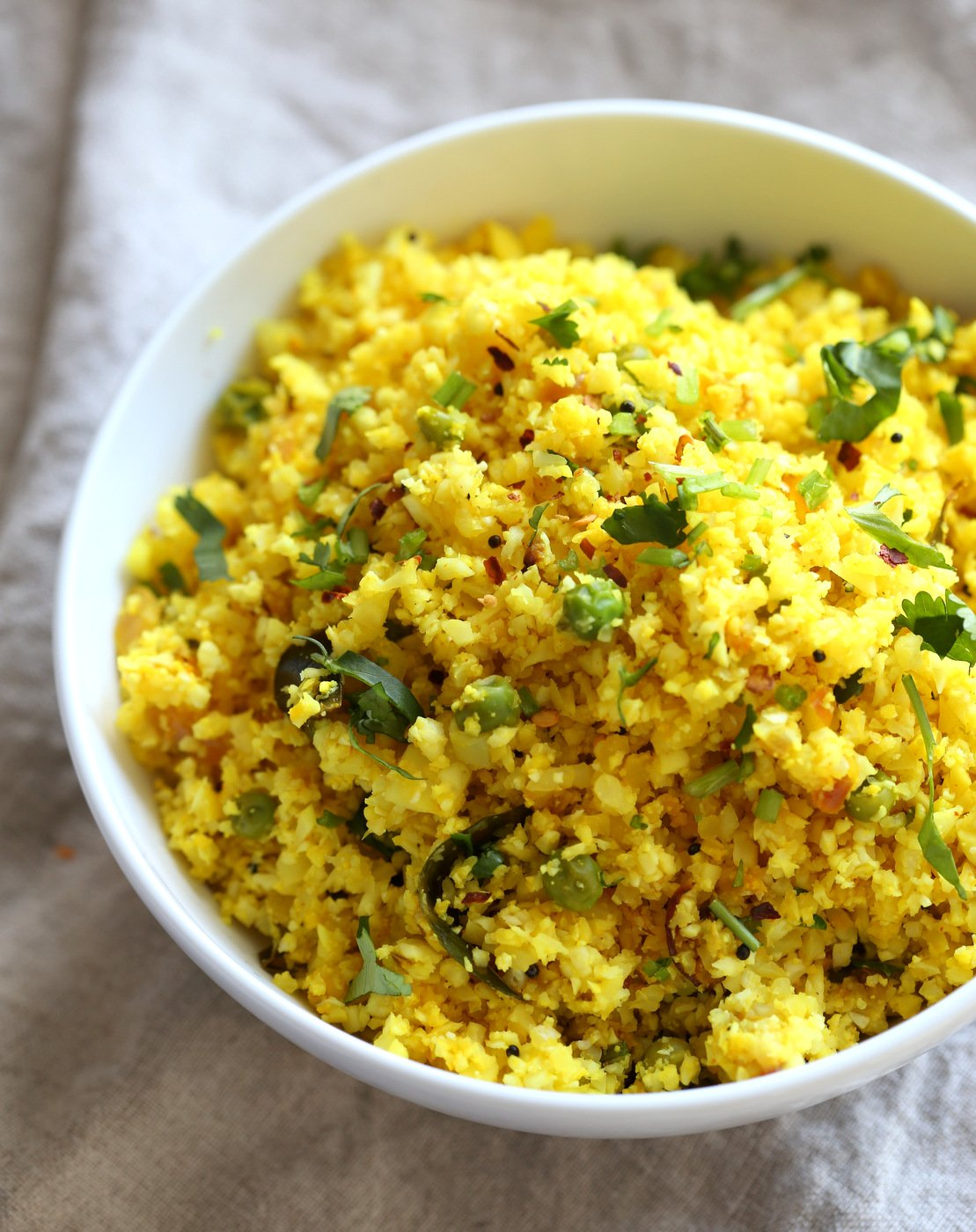 Lemony Turmeric Cauliflower Rice. Easy Side with any meal. 1 Pot Lemon Cauliflower Rice with mustard seeds and garlic. #Vegan #Glutenfree #Grainfree #Nutfree #Recipe #Turmeric #cauliflowerrice #veganrucha