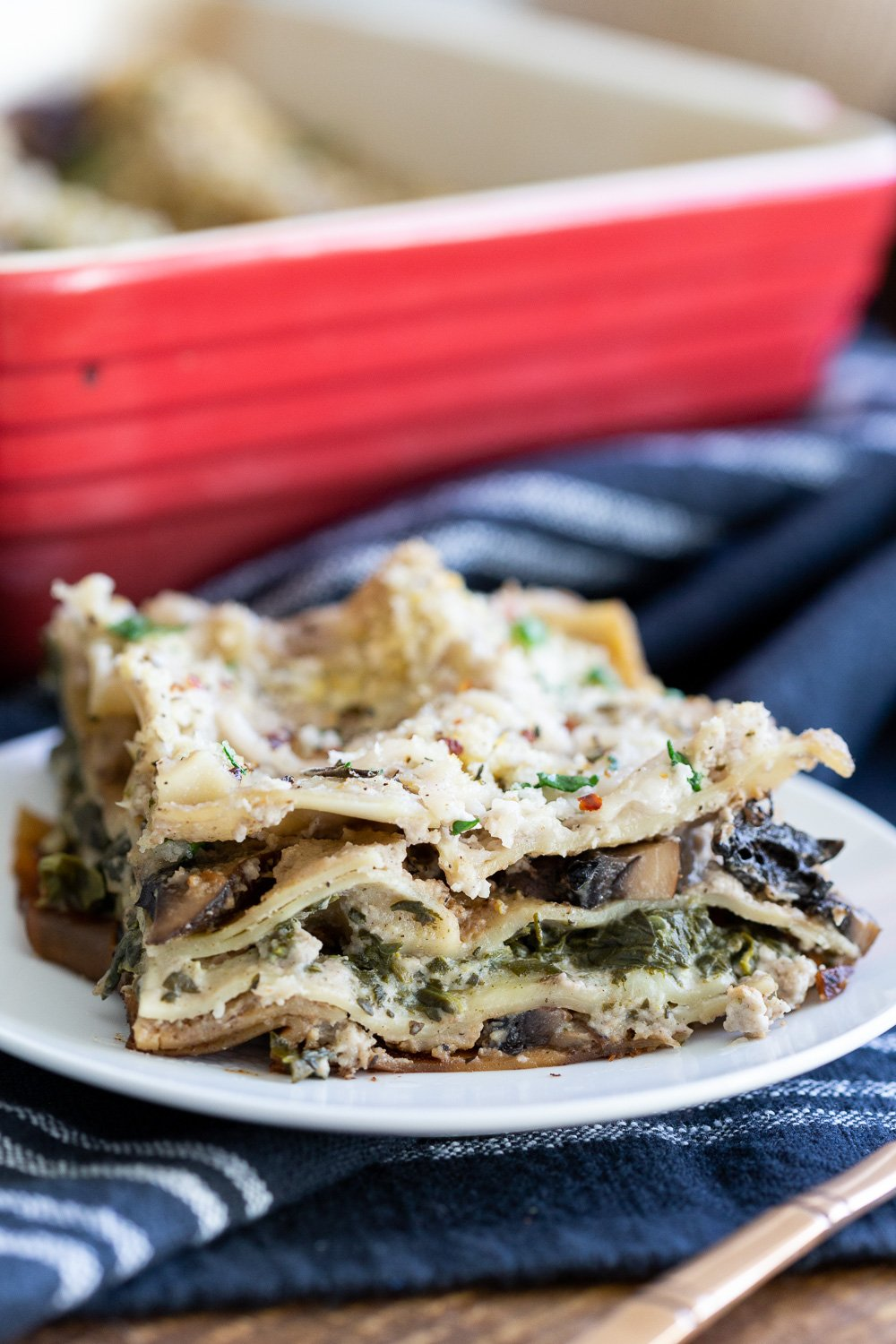 Our Creamy Vegan Mushroom Lasagna slice on a white plate