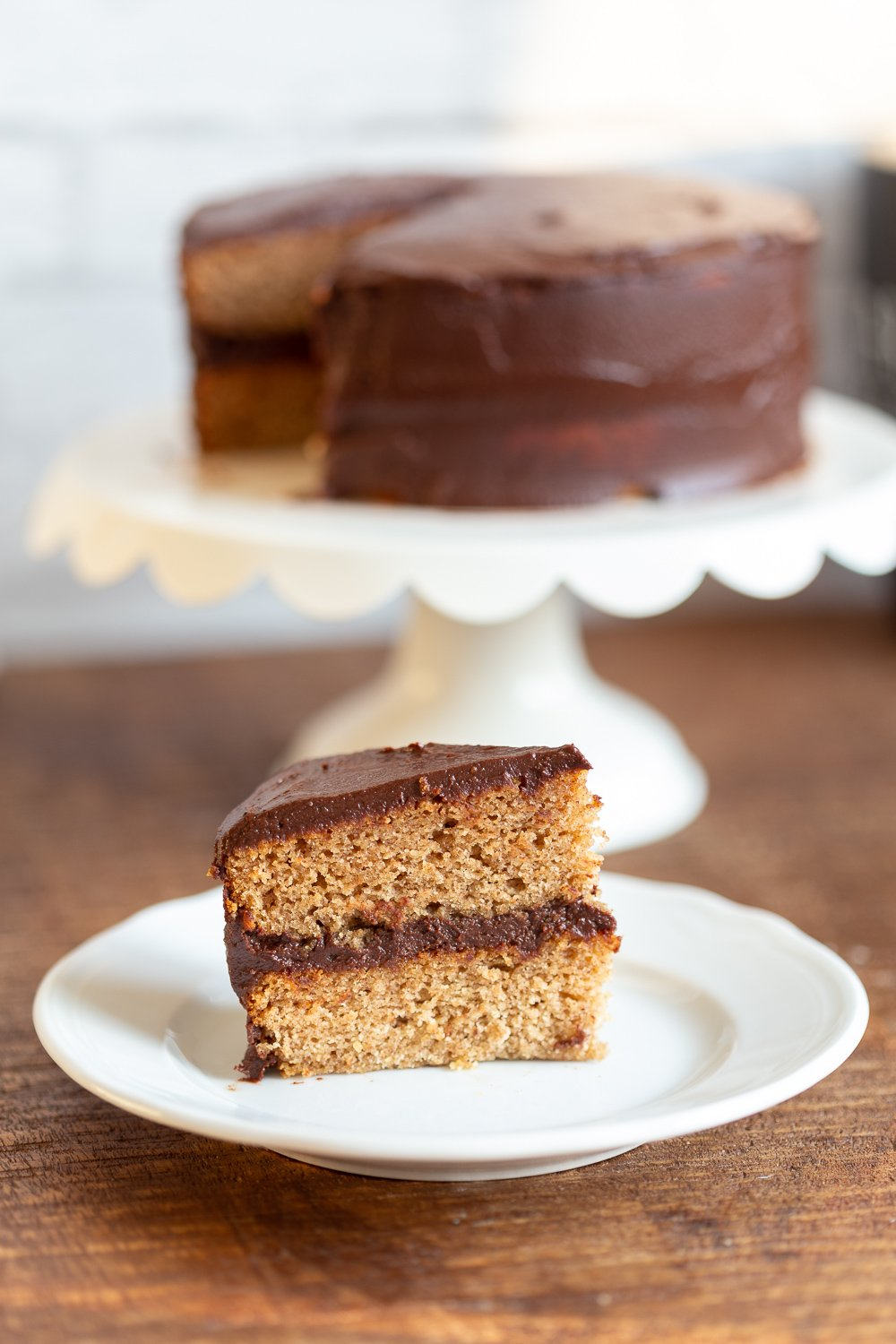 The Best Vegan Gluten free Vanilla Cake with Chocolate Frosting. Soft and delicious Vanilla cakes sweetened with dates. #Vegan #Glutenfree #vanillacake #gumfree #eggless #Recipe #veganRicha Can be #refinedsugarfree.