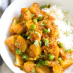 a serving of Indian Aloo Matar Pea and Potato Curry with a side of rice