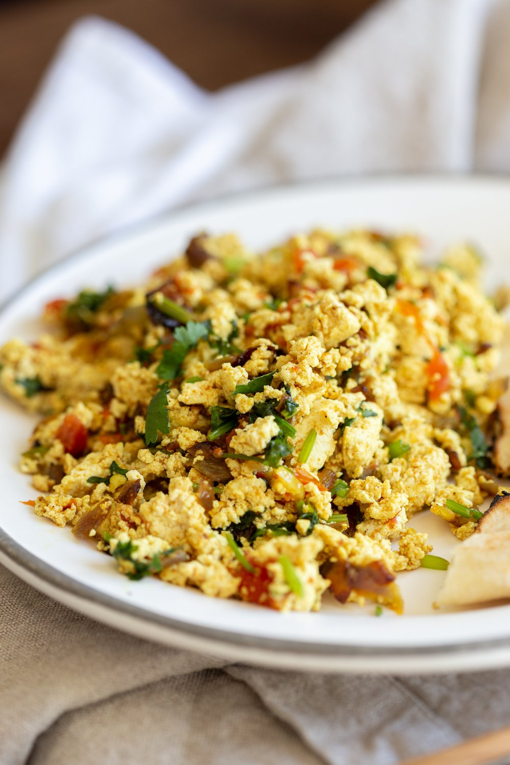 Our Vegan Tofu Bhurji in a white plate with border