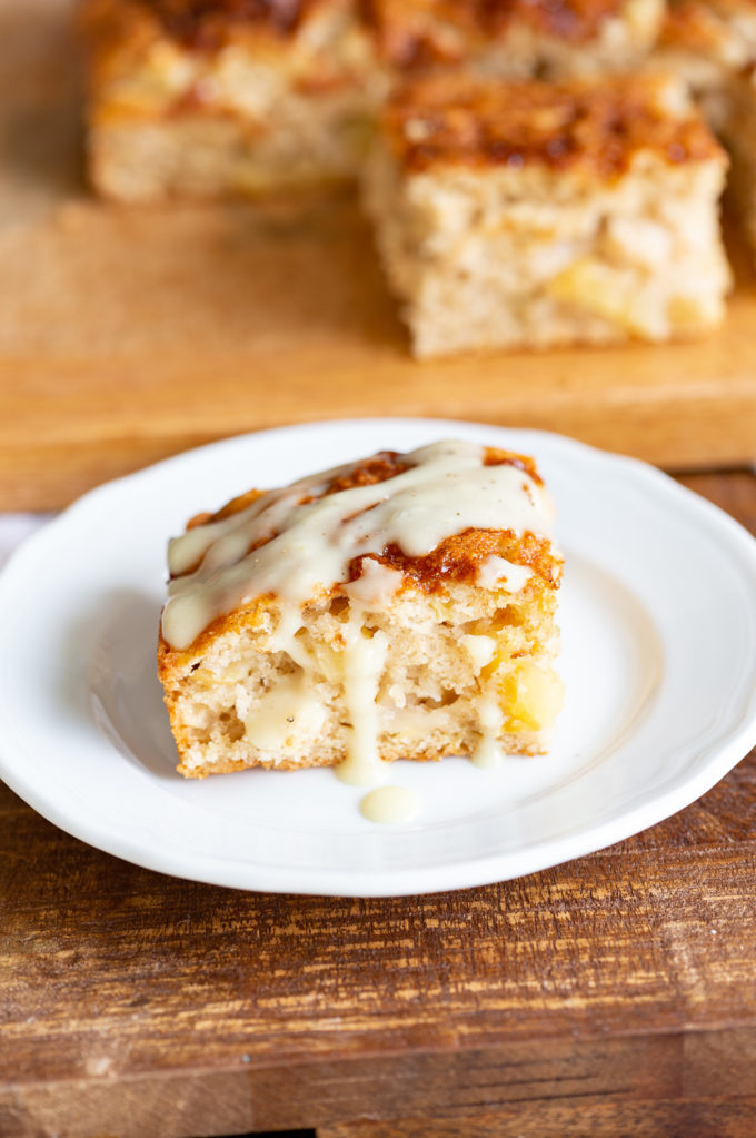 Vegan Apple Cake with Cinnamon Custard. Easy Apple Cake that is soft and light. Served with a creamy vegan vanilla custard.#VEgan #VeganRicha #VeganAppleCake #Soyfree #Recipe Nut-free Gluten-free Options