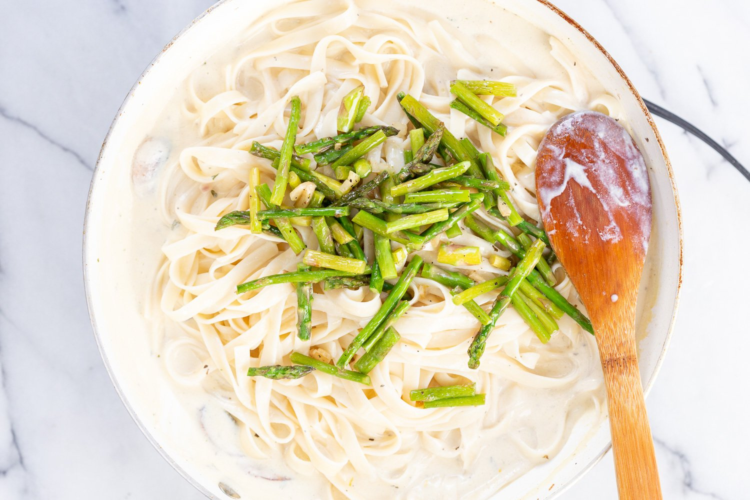 Vegan Lemon Asparagus Pasta - 30 mins! Creamy Lemon Alfredo style sauce with tofu with fettuccine and pan roasted garlic asparagus and more lemon. #Vegan #Nutfree #Recipe. Can be Glutenfree #VeganRicha #LemonAsparagusPasta 17 gm of protein