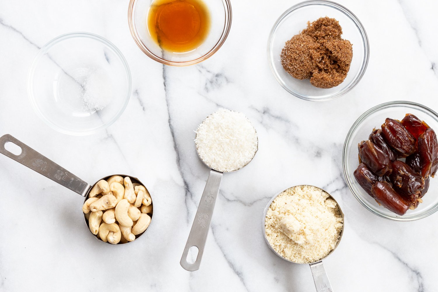 Ingredients for our Vegan Cookie Dough Bites in bowls and measuring cups