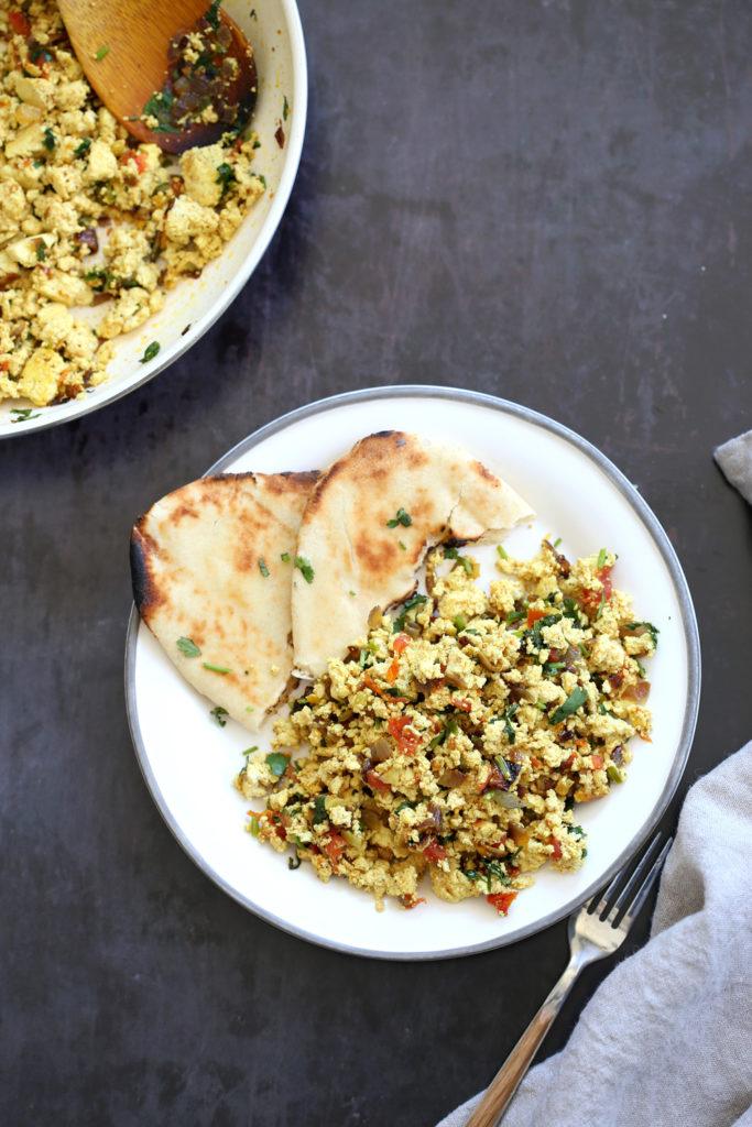 Tofu Bhurji - Vegan Bhurji or Akoori . Indian Scrambled eggs. Tofu scrambled with onion, tomato, cilantro and cumin for a delicious Eggless Bhurji Scramble Breakfast. #Vegan #Glutenfree #Nutfree #Recipe #VeganRicha #indianRecipe #tofuburji Can be soyfree.