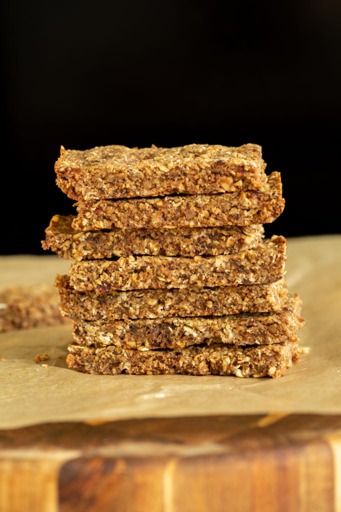 side view of a stack of vegan caramelized banana granola bars