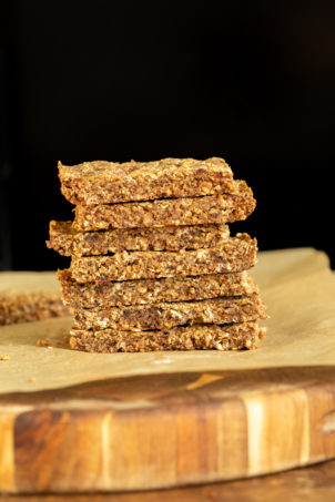 a stack of vegan banana nut granola bars with caramelized bananas