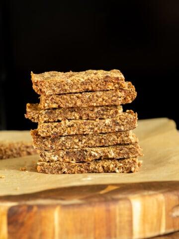 a stack of vegan banana nut granola bars with caramelized bananas
