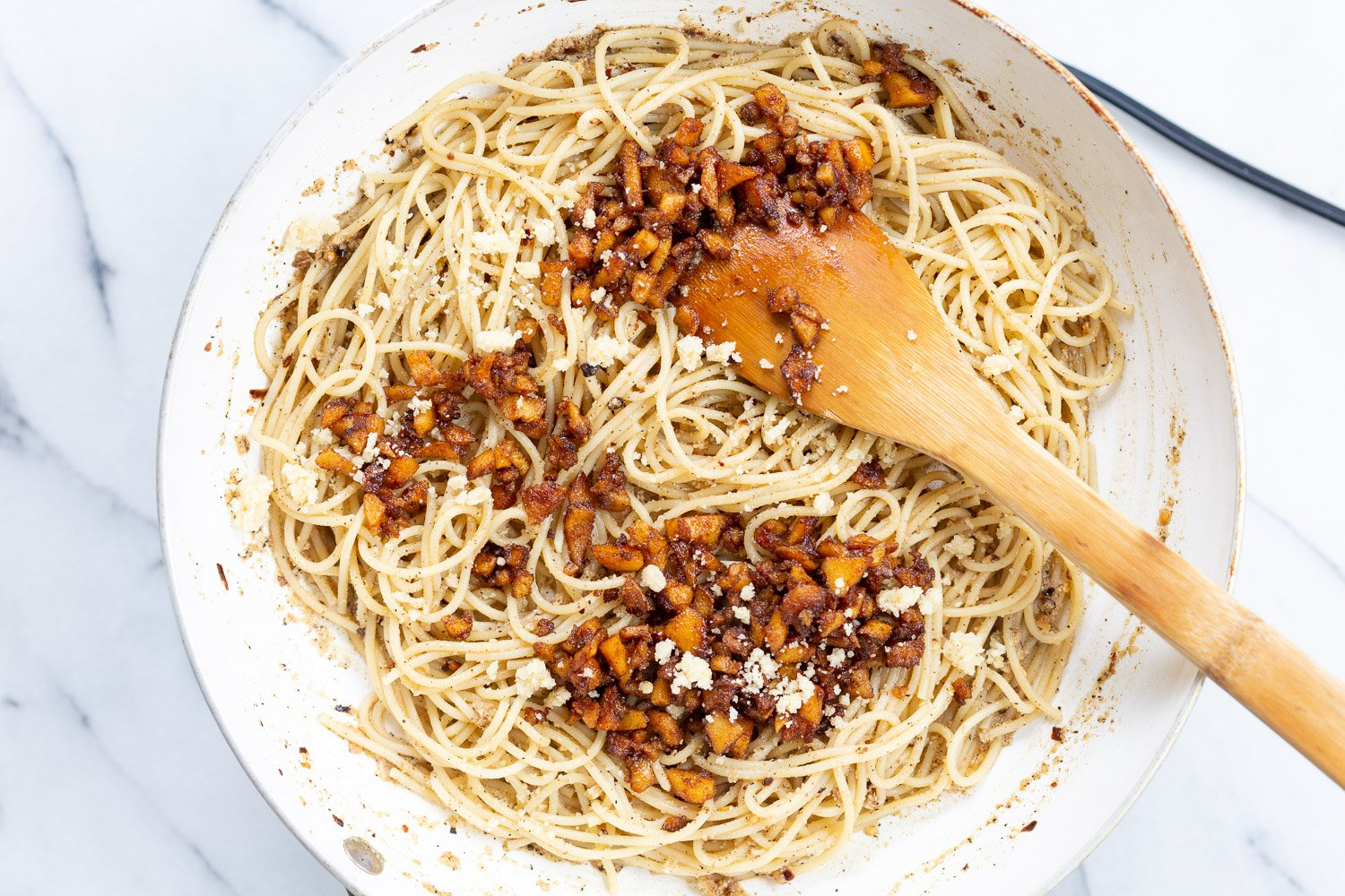 Our Vegan Cacio e Pepe with Smoky Balsamic Chickpea Tofu Bits in a white skillet