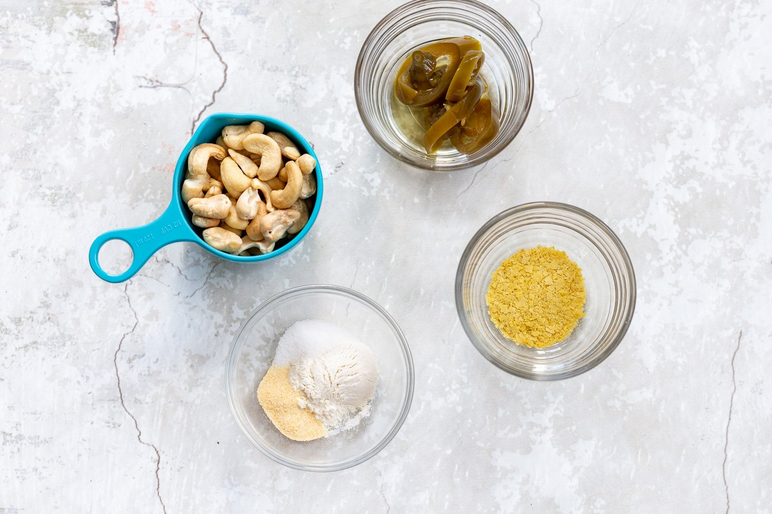 Ingredients for Vegan Jalapeno Cream Sauce in bowls and measuring cups