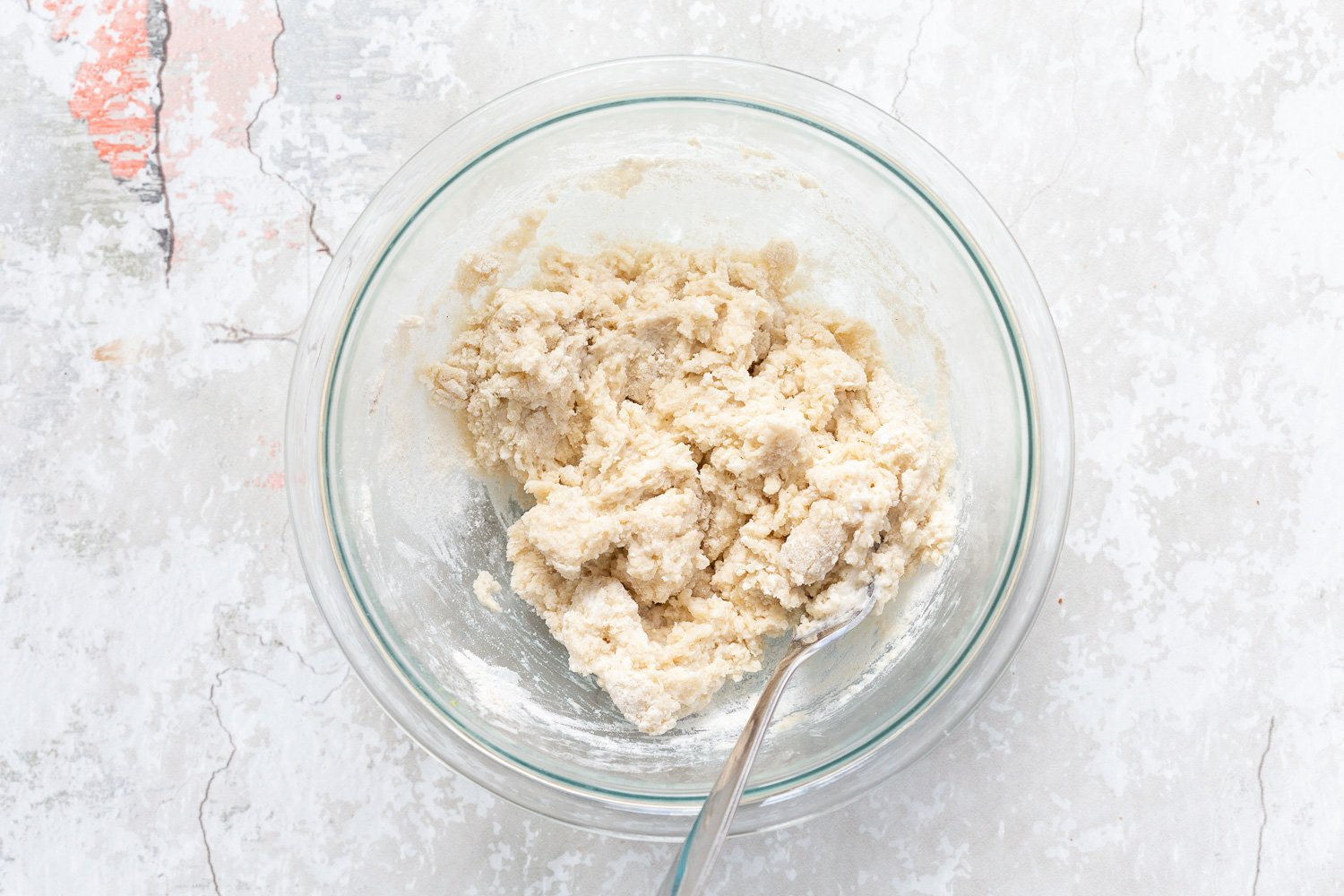 Dough in a glass bowl for the biscuit topping of our Vegan Blueberry Cobbler