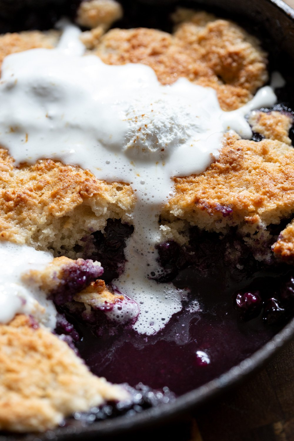 Our Vegan Blueberry Cobbler in a Cast Iron skillet