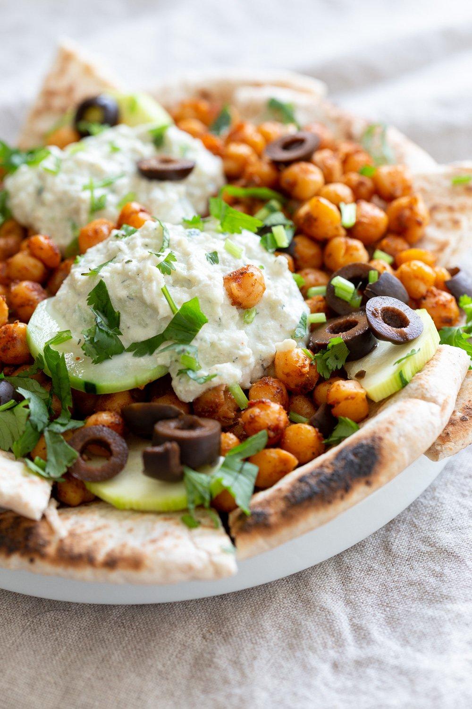 Vegan Mediterranean Nachos in white plate
