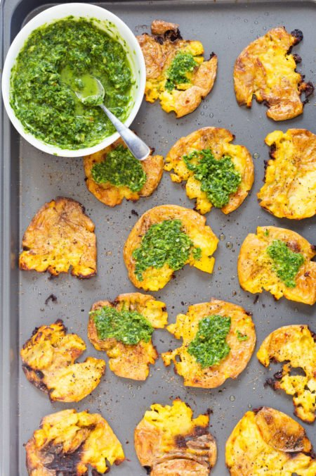 Crispy Vegan Smashed Potatoes with Chimichurri. These Smashed potatoes are baked to a crisp and served with fresh homemade parsley chimichurri. #VeganRicha #VeganSmashedPotatoes #Vegan #Glutenfree #Nutfree #Soyfree #Recipe
