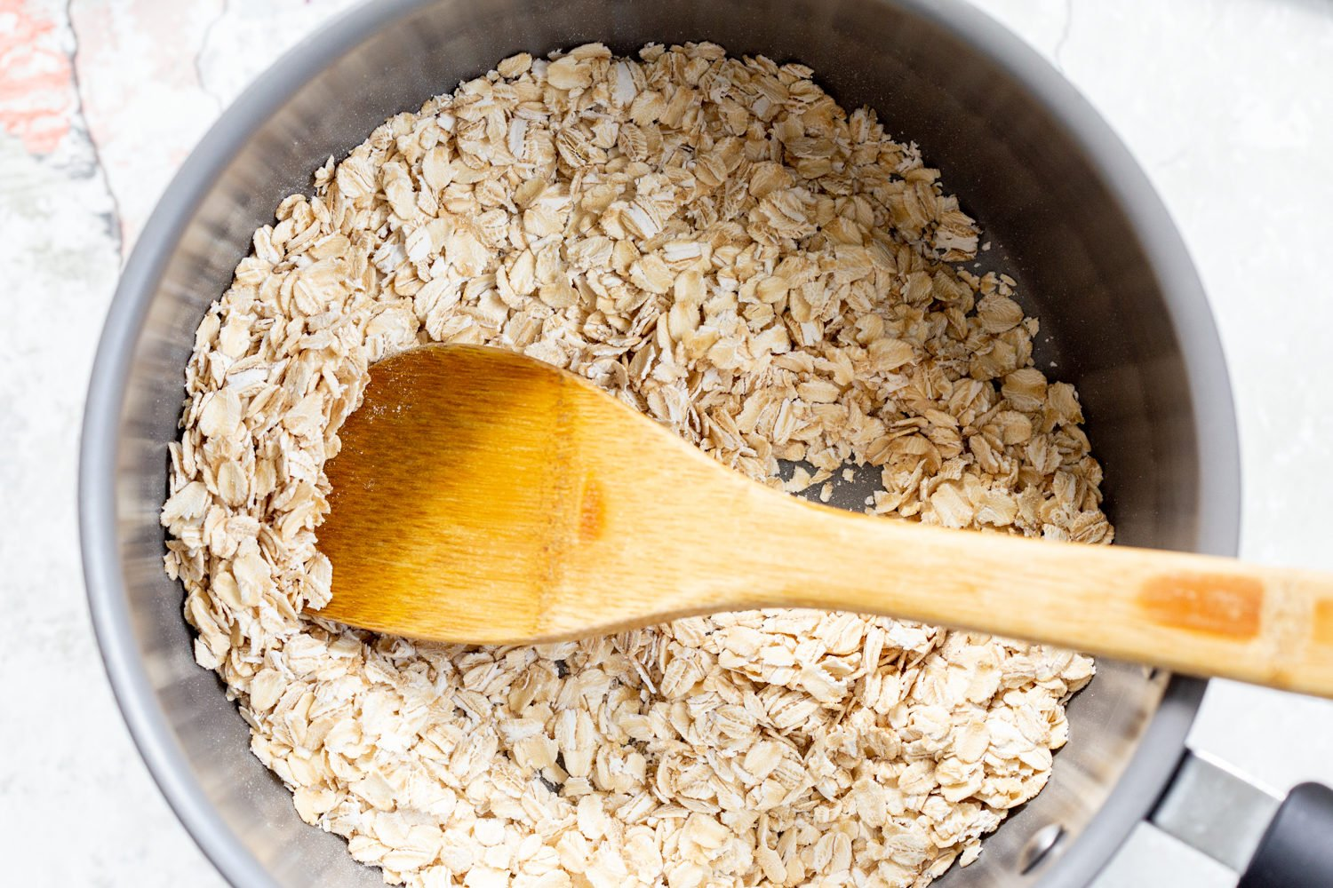 Oats toasted for our Vegan sunbutter Granola Bars in a saucepan
