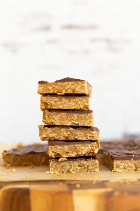 Sliced Sunbutter Granola Bars stacked on wood board