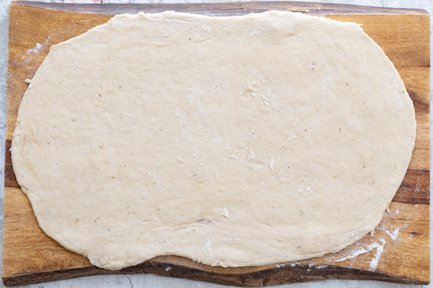 Vegan Pizza rolls dough being rolled out into a rectangle