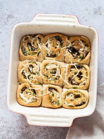 overhead shot of Pesto Pizza rolls in a white casserole dish