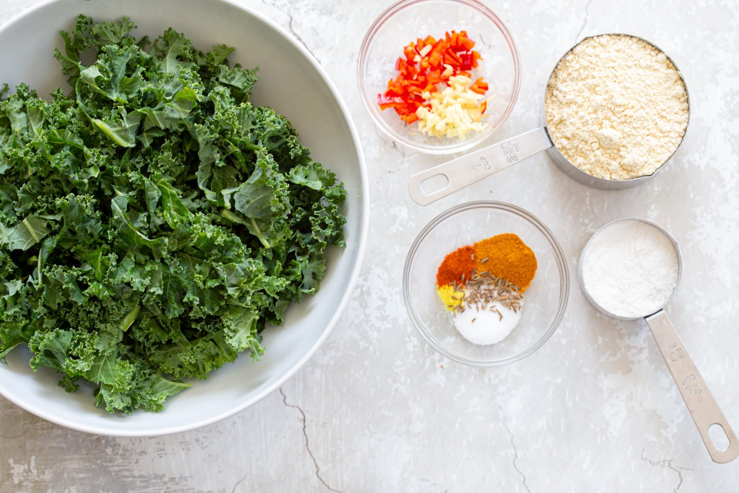 Ingredients laid out for Kale Pakora in bowls