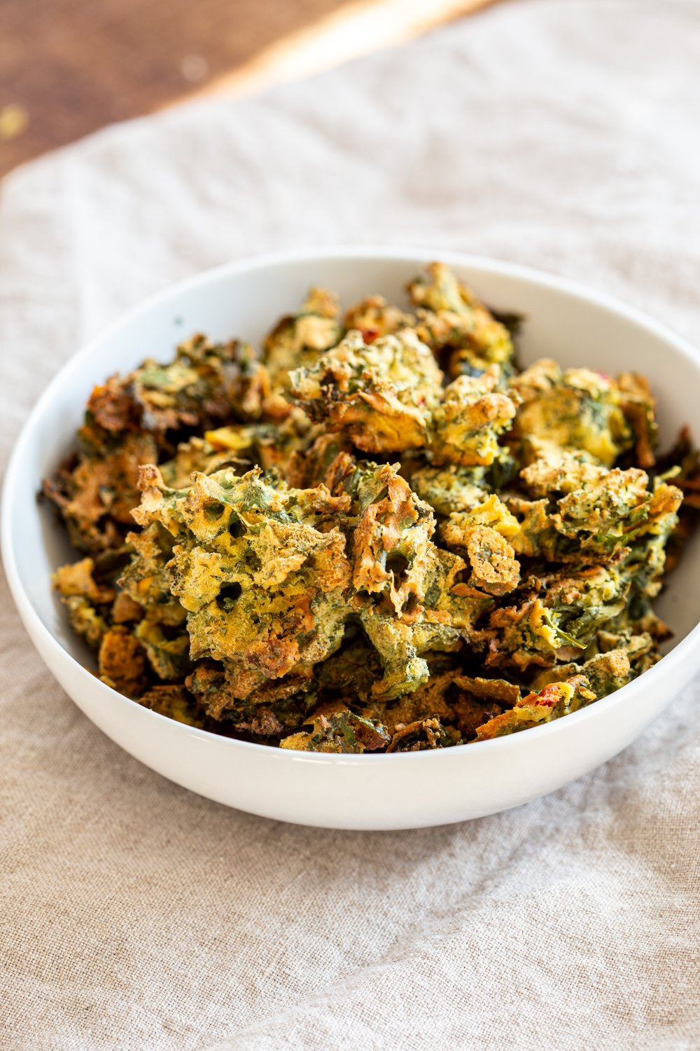 Kale Pakora in a white bowl