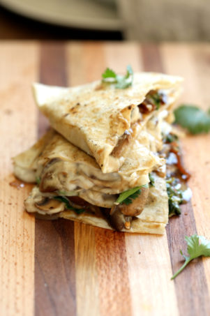 Grilled and sliced Vegan Mushroom Quesadilla on Wood board