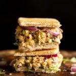 Our Chickpea Tahini Saladi n a Sandwich on wood board
