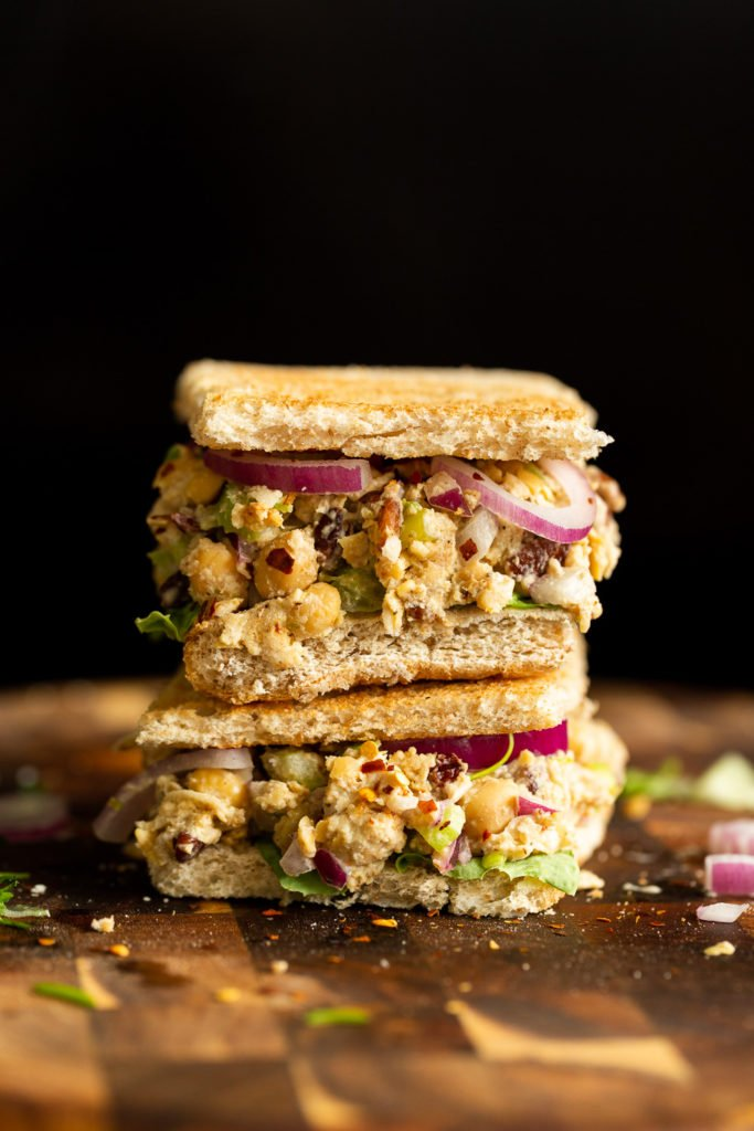 Our Chickpea Tahini Saladi n a Sandwich on wood board