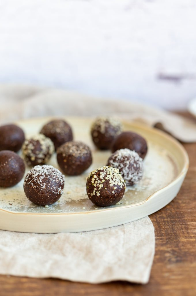 Our Raw Vegan Brownie Bites on white speckled plate