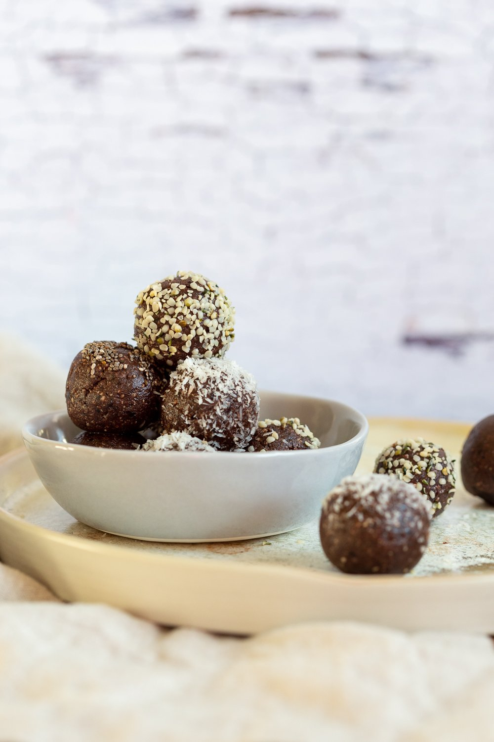 Our Raw Vegan Brownie Bites in grey bowl