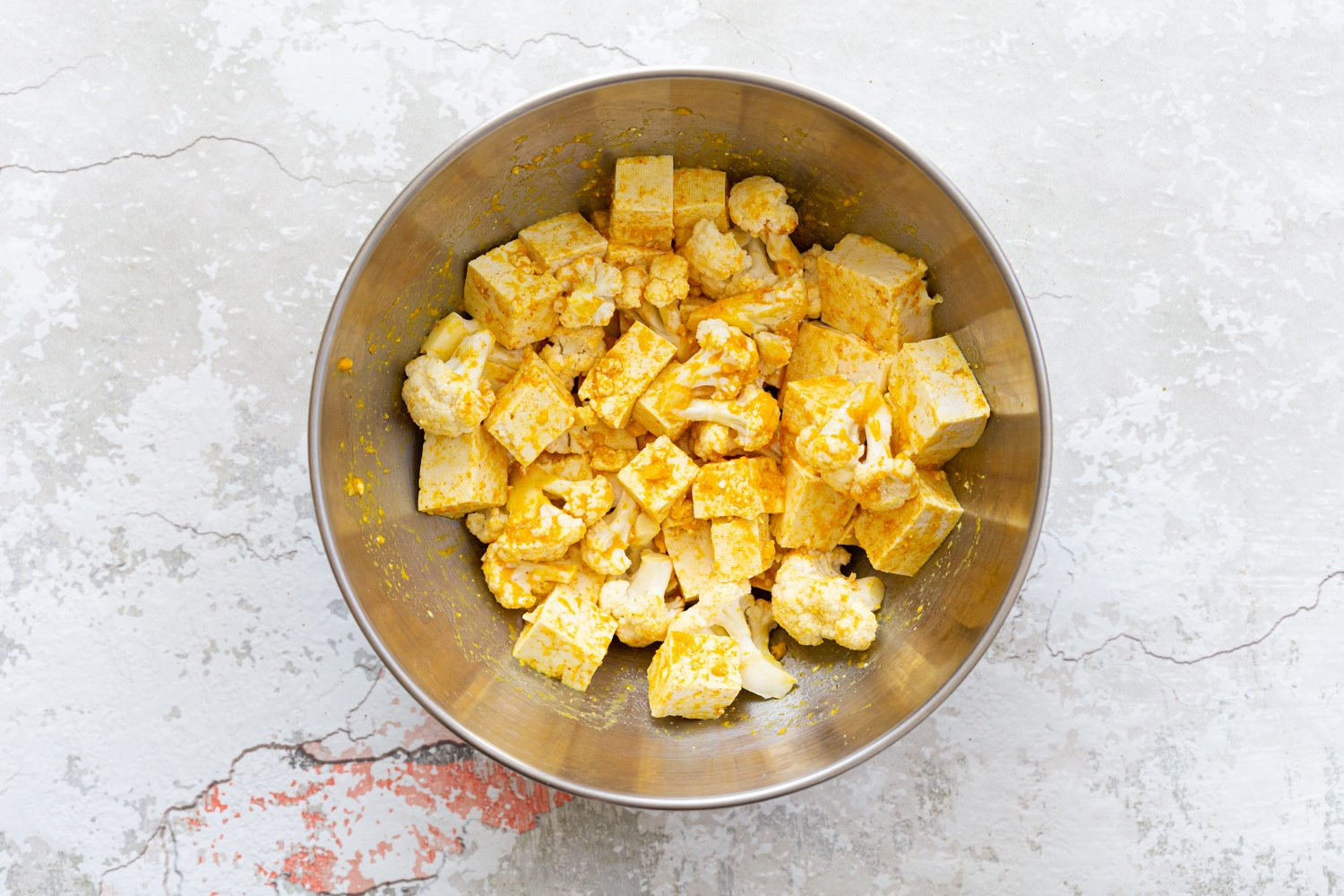 Tofu and Cauliflower in a steel bowl