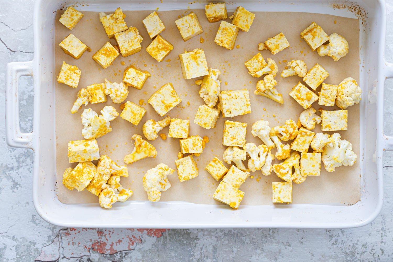 Tofu and Cauliflower in white baking dish