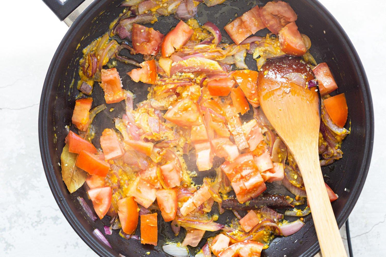 Ingredients for Kohlapuri sauce in black skillet