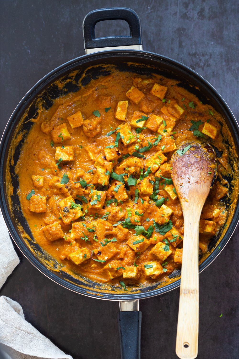 Tofu and Cauliflower in Indian Kolhapuri Sauce in a Black skillet