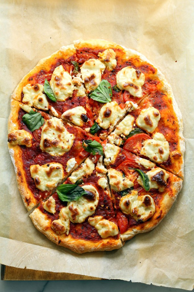 Our Vegan Margherita Pizza on parchment