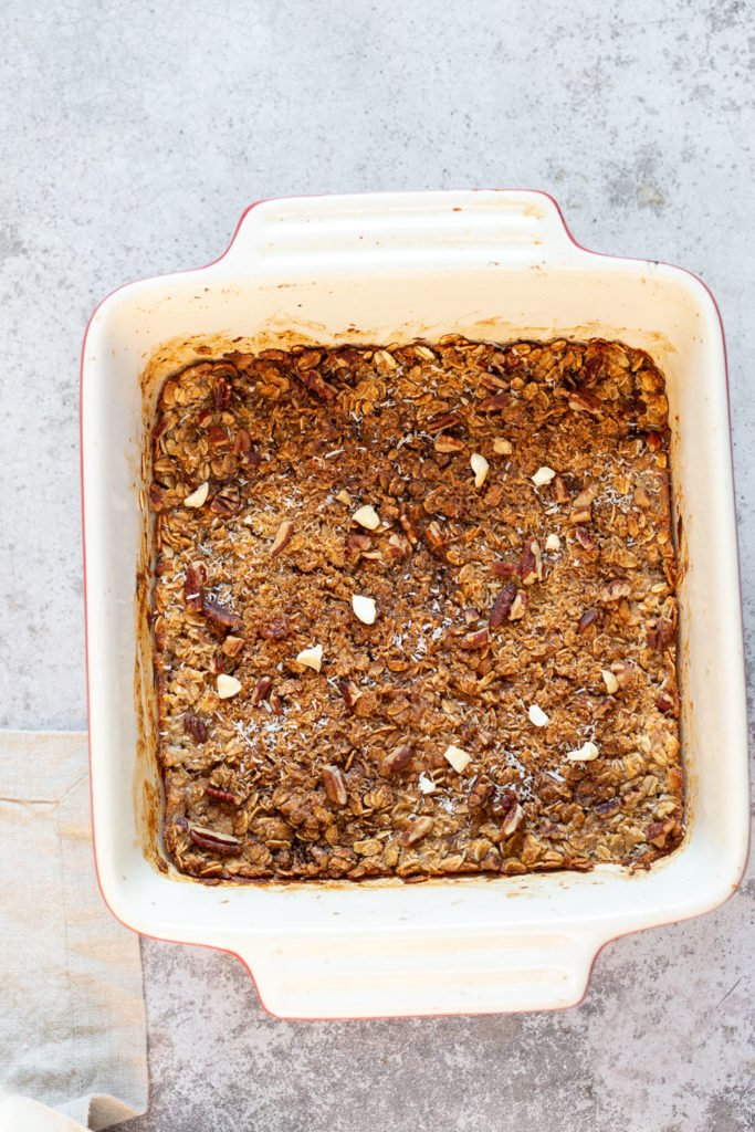 Our Vegan Banana Bread Baked Oatmeal in a white baking dish