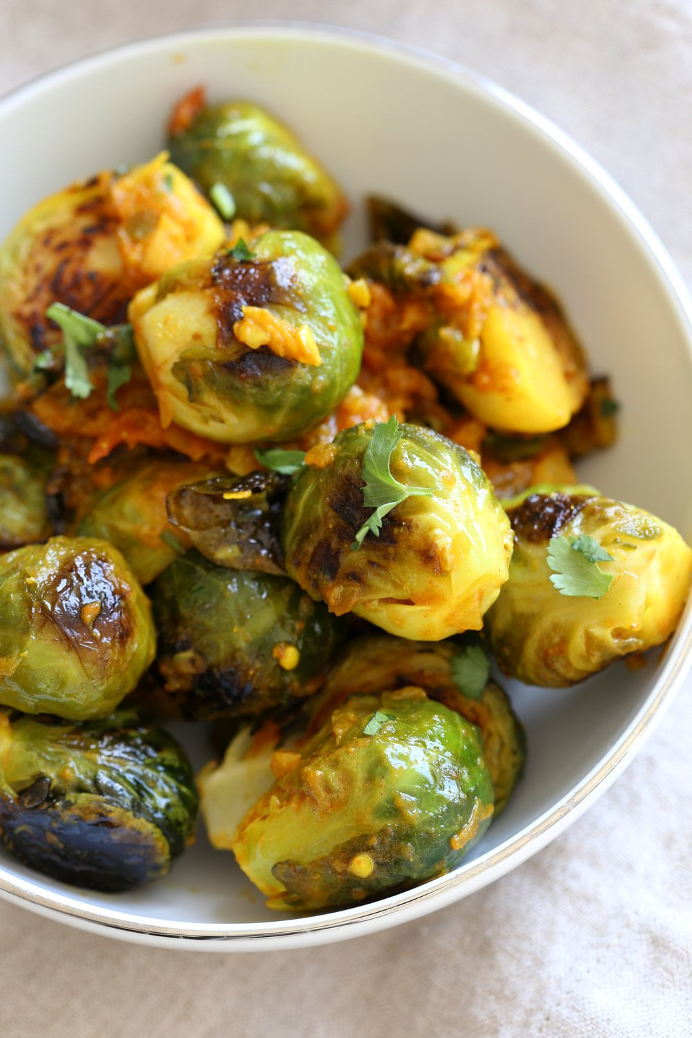 Our Curried Caramelized Brussels Sprouts in White Bowl