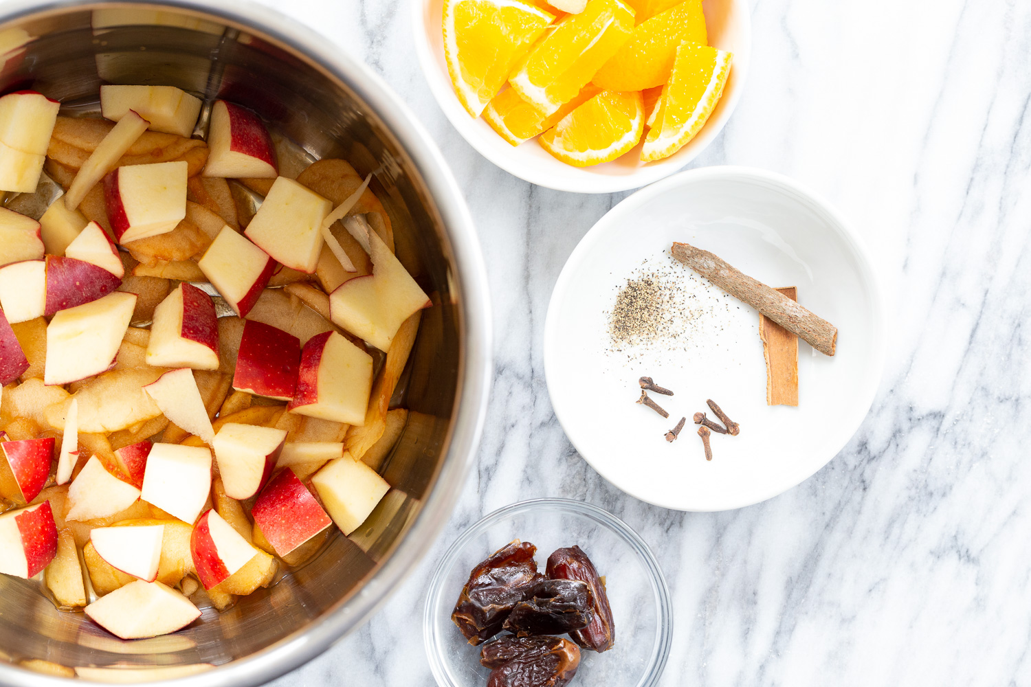 Ingredients for Instant Pot Apple Cider in Bowls