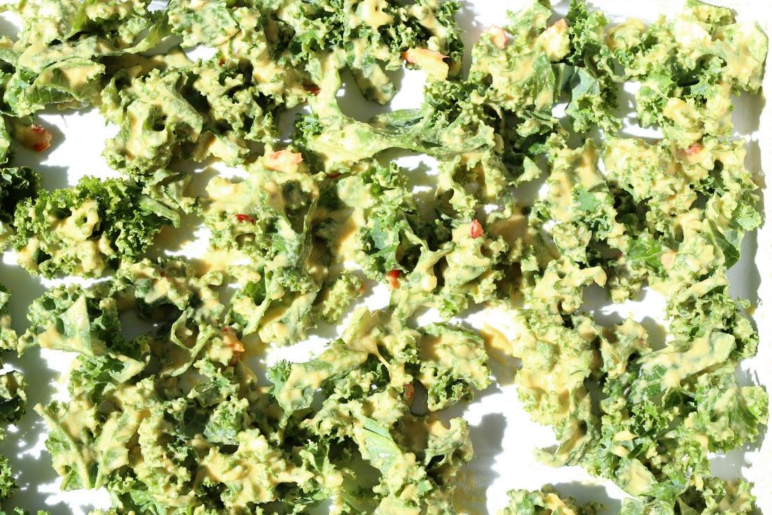 kale pakora in white baking dish