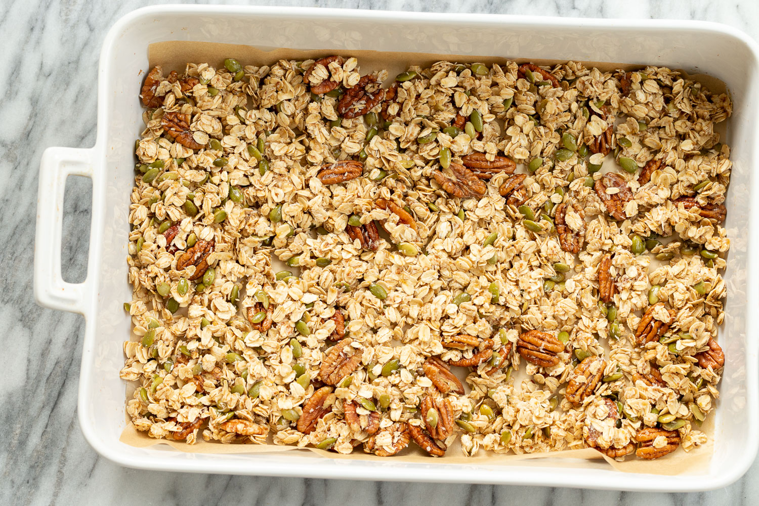 Our Vegan Maple Pecan Granola in a white baking dish