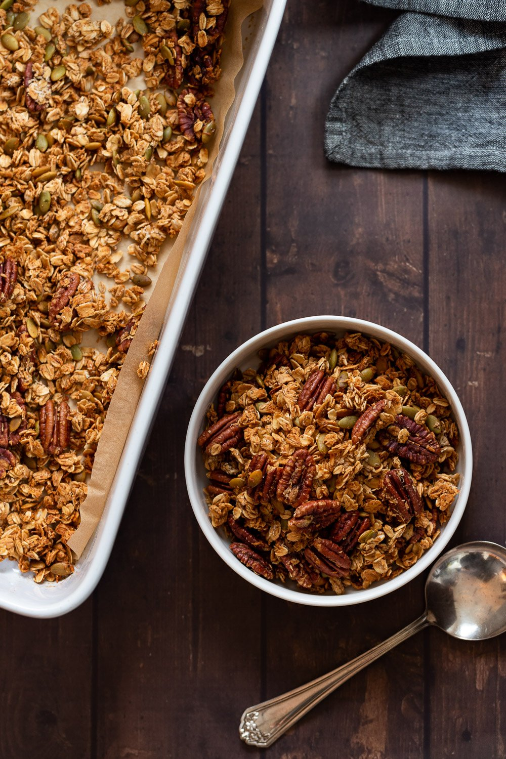 Our Maple Pecan Granola in white bowl and baking dish