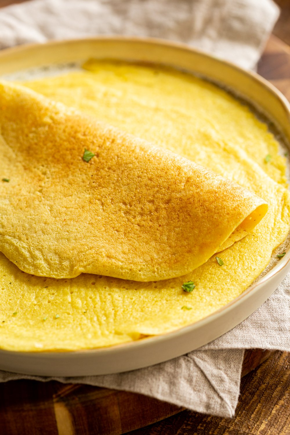 Plain Vegan Omelet made with Mung Beans on a white plate