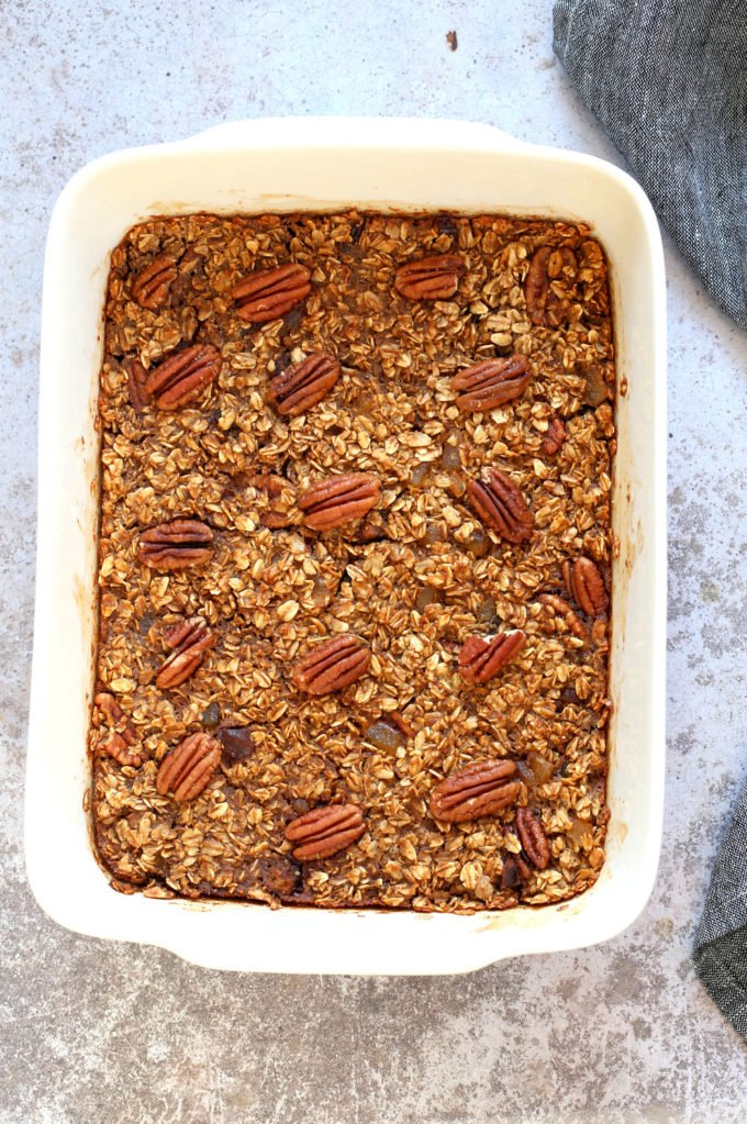 Vegan Gingerbread Baked Oatmeal in a white baking dish