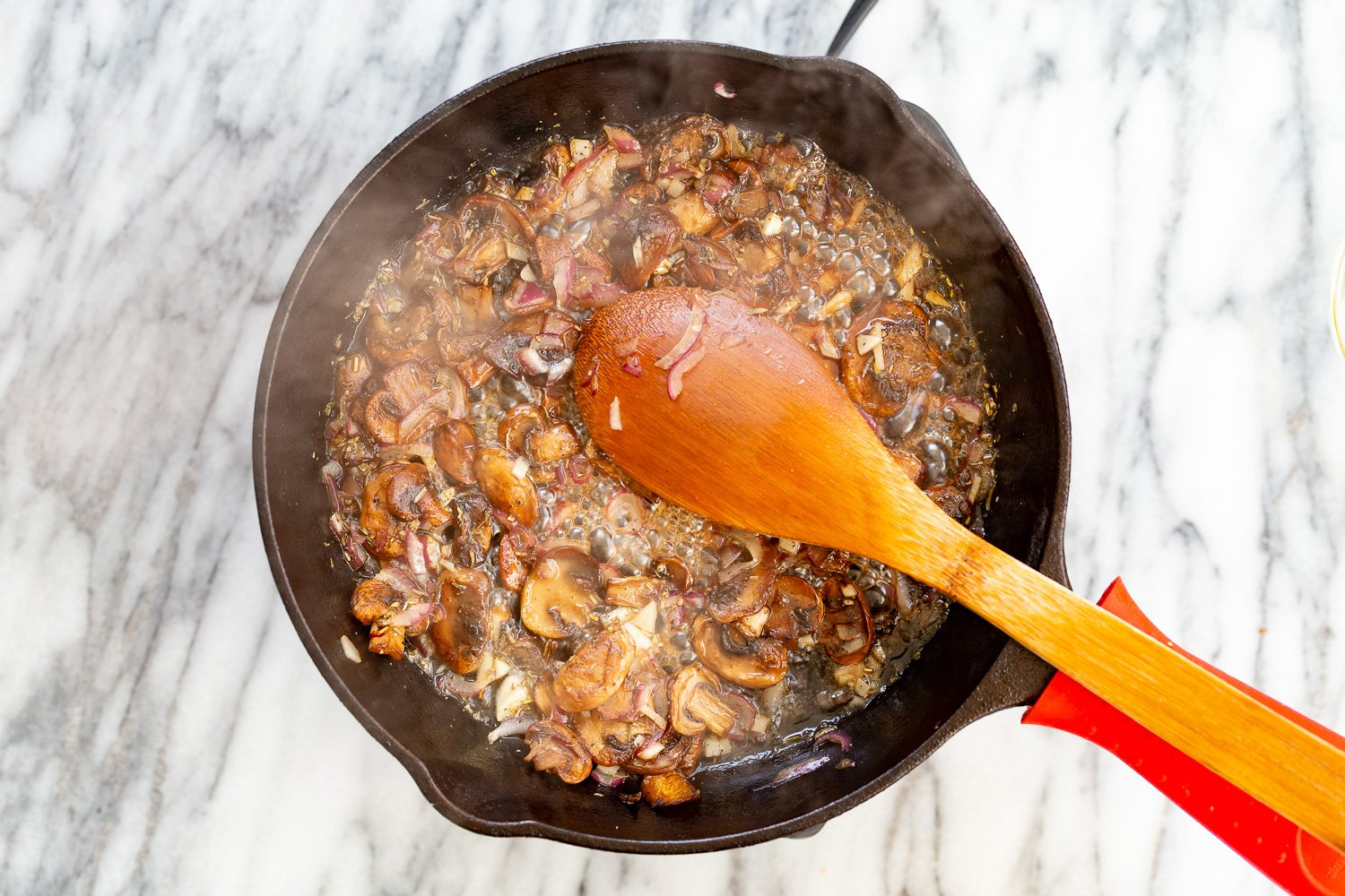 Mushrooms and wine in a cast iron skillet