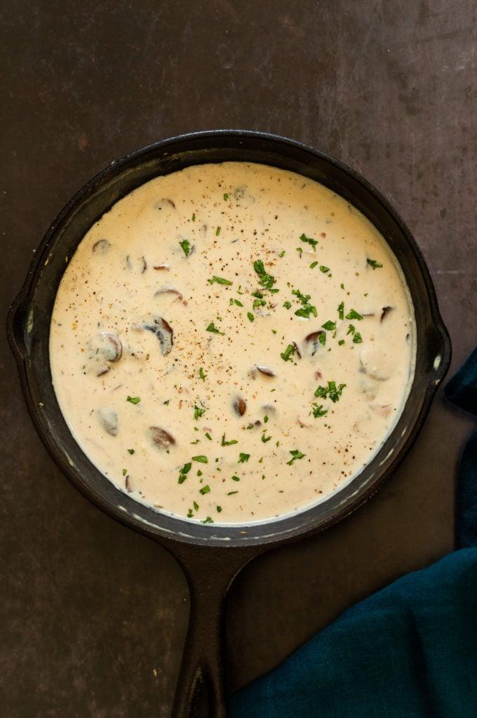Creamy Vegan Mushroom Sauce in a cast iron skillet