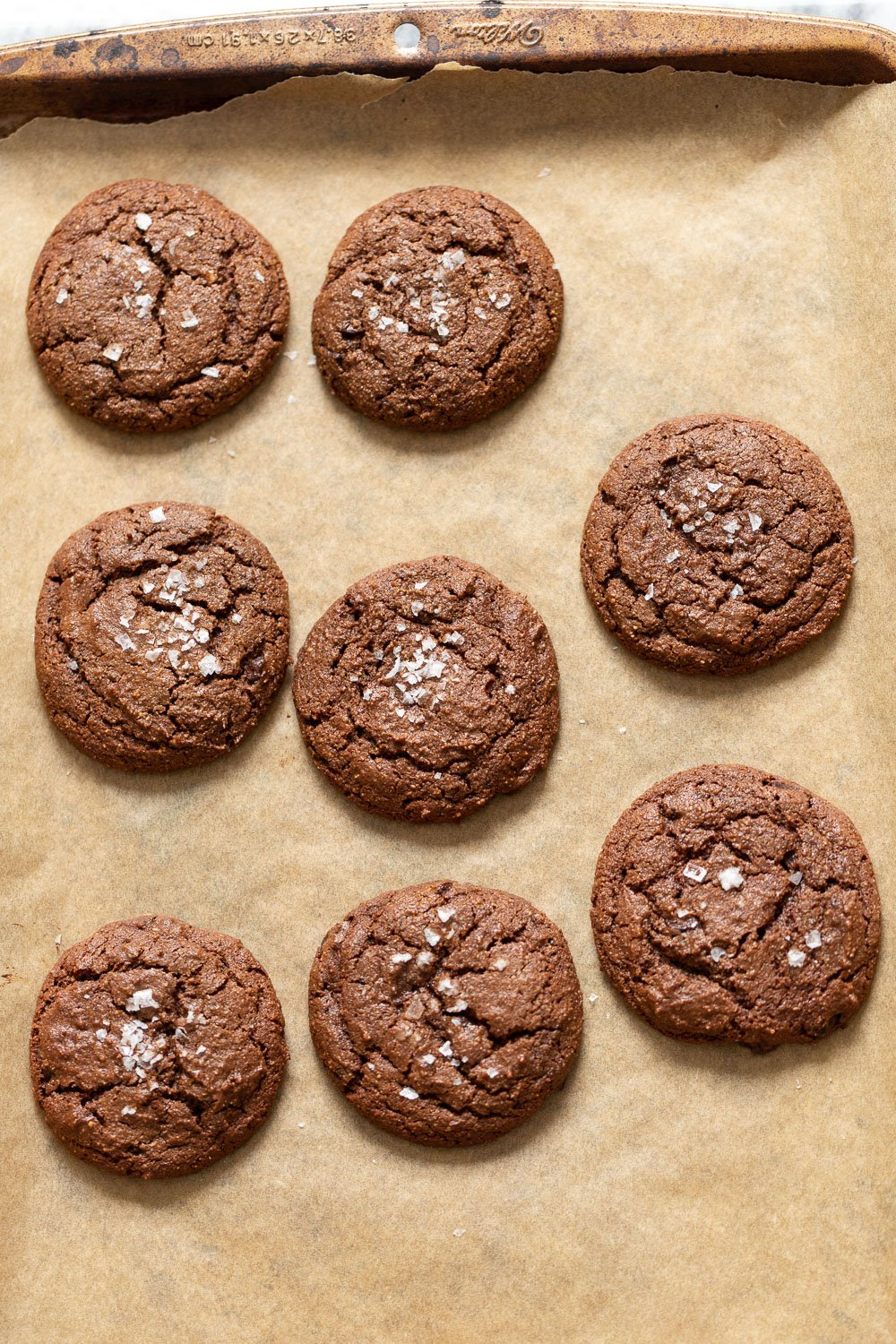 Vegan Brownie Cookies on Parchment lined sheet