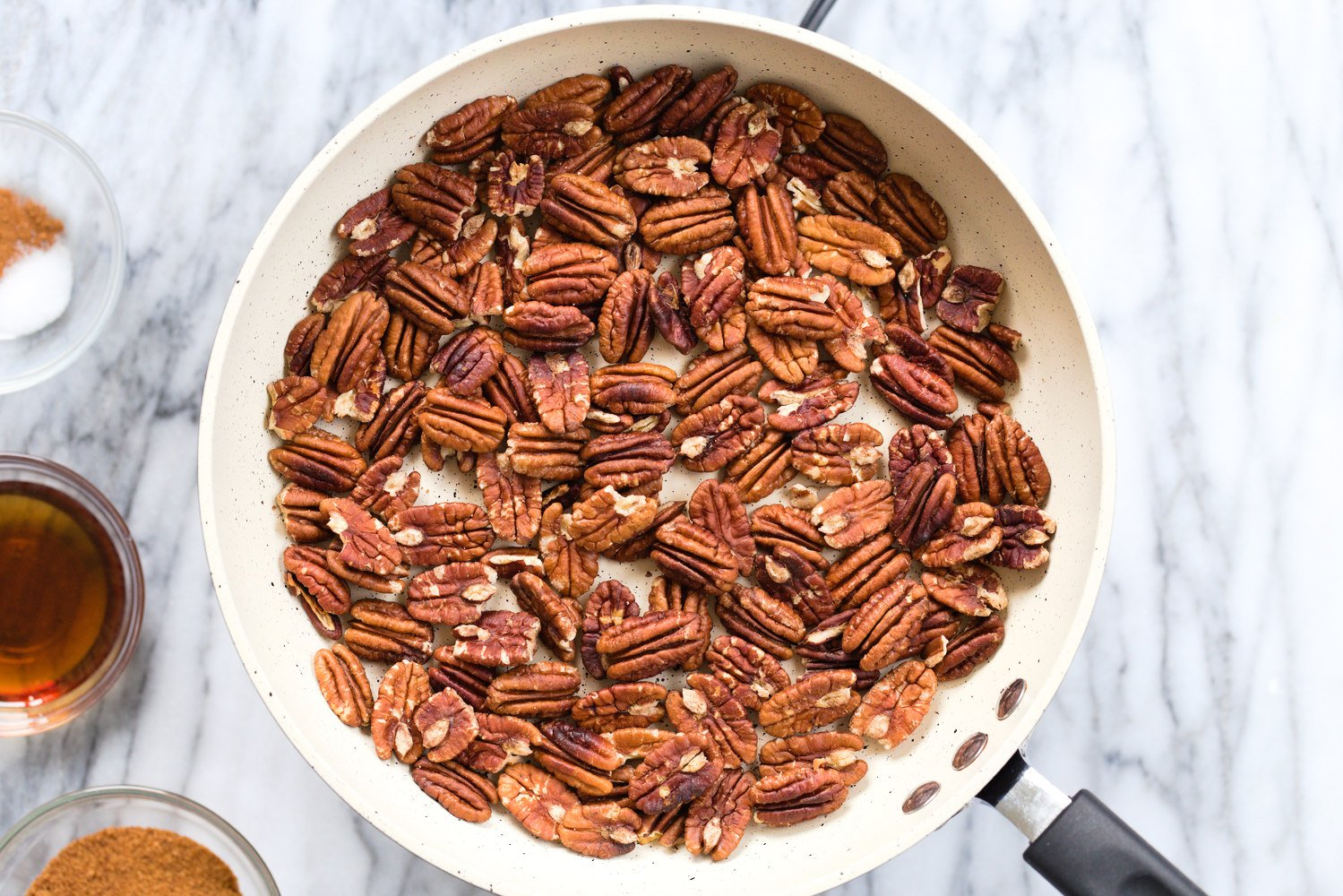 Toasted Pecans in a white skillet