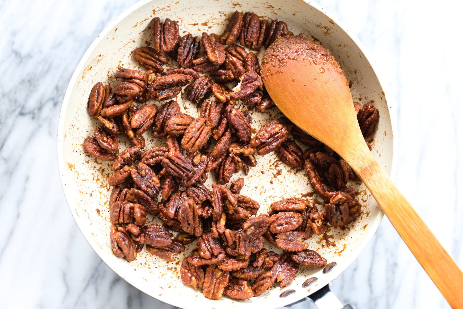 Toasted Candied Pecans in a white skillet