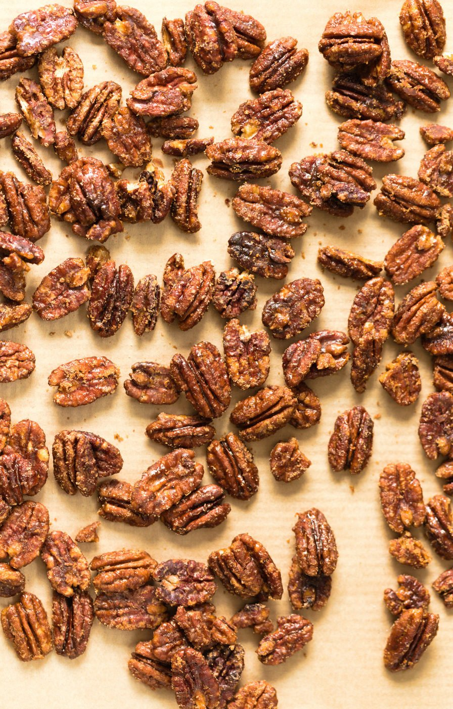 Vegan Candied Pecans on parchment lined sheet